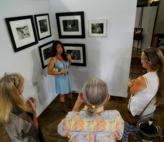 "Amy Jasek talks about her work at the opening of ""Family"" in the new gallery space. Photo by Kevin Tully."